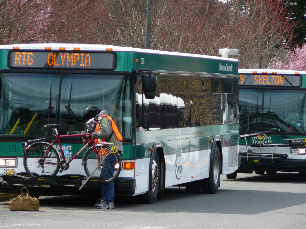 Person loading their bicycle on an MTA bus heading to Olympia.