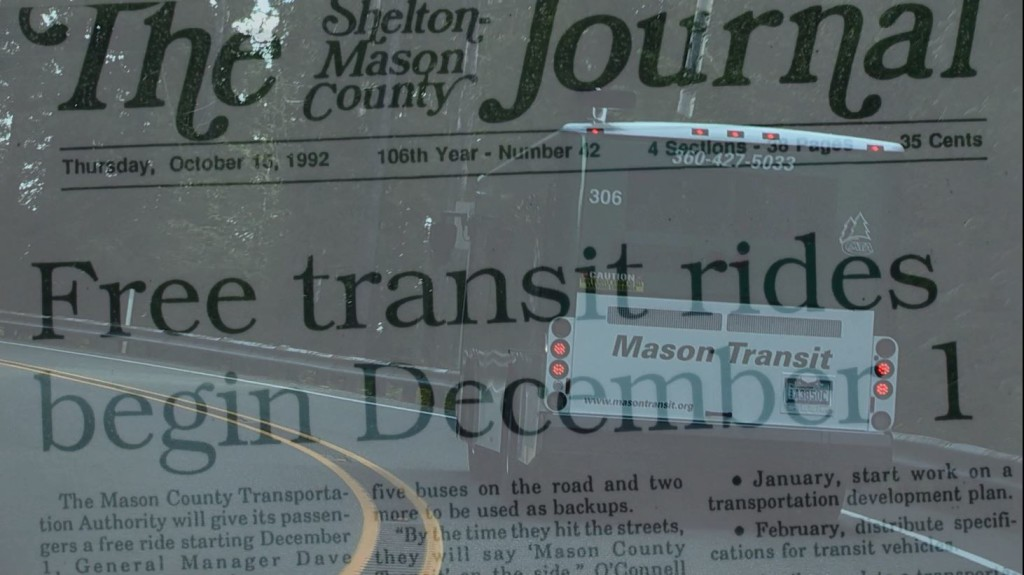An MTA bus juxtaposed with an article from The Journal announcing MTA's first day of service and being fare-free.