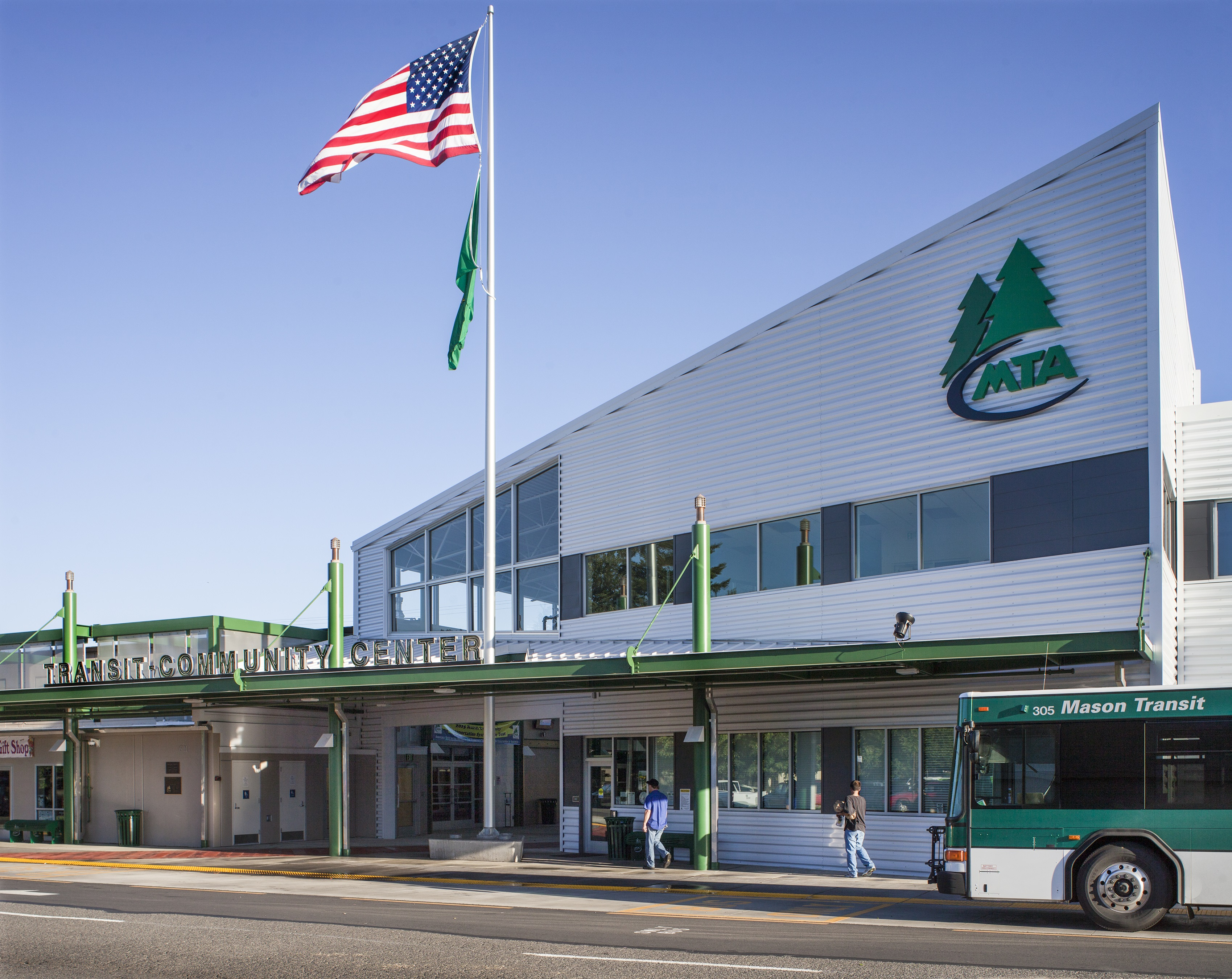 Photo showing the exterior of the MTA Transit-Community Center building with an MTA bus pulling up to the front.